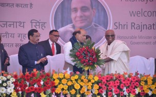 Madhu Pandit Dasa, Chairman presenting Sri Rajnath Singh, Minister of Home Affairs,  with a bouquet of flowers as a token of appreciation.