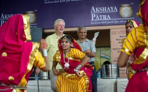 Clinton is delighted to watch a cultural programme arranged at the school. Photo credit: Clinton Foundation/ Barbara Kinney