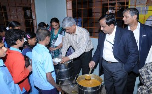 Participants served meals to children at a beneficiary school in Jayanagar
